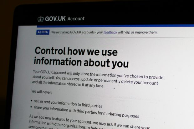 "Laptop screen showing a GOV.UK page titled ""Control how we use information about you"""