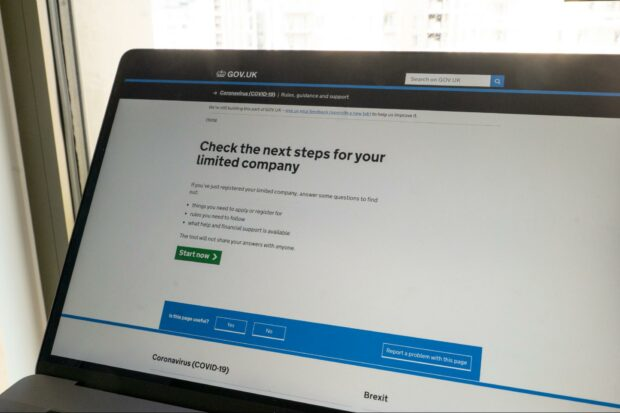 """A laptop with """"Check the next steps for your limited company"""" on its screen."""