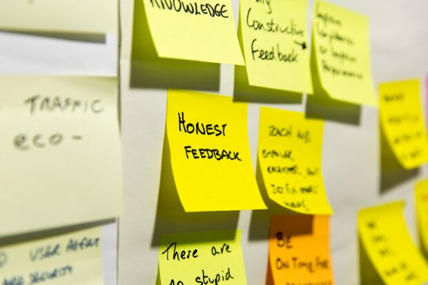 """Lots of post-its with one in the centre saying """"Honest feedback"""""""